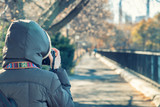 Female photographer taking pictures of Central Park on a winter day, New York City - 238689327