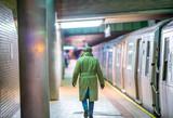 Afro american man at night entering subway train, back view - 238689538