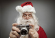 Santa Claus taking holiday pictures