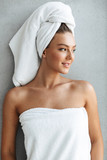 Beautiful young woman wrapped in a bath towel - 238711102