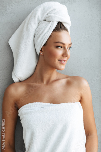 Zobacz obraz Beautiful young woman wrapped in a bath towel