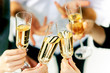 Celebration. Hands holding the glasses of champagne and wine making a toast. The party, alcohol, lifestyle, friendship, holiday, christmas, new, year and clinking concept