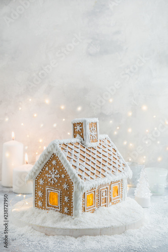 beautiful handmade gingerbread house with snow for Christmas and New Year, white backround