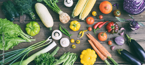 White, yellow, green, orange, red, purple fruits and vegetables on wooden background. Healthy food. Multicolored raw food.