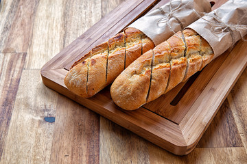 French baguette on wooden background