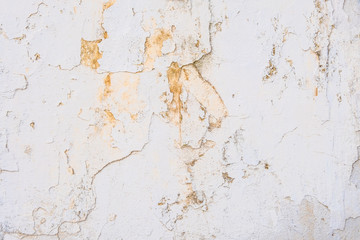Background of old white cracked wall
