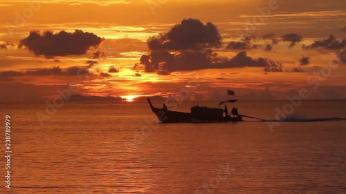 Long tailed boat in sunset scenery in Hat Chao Mai national park, Thailand