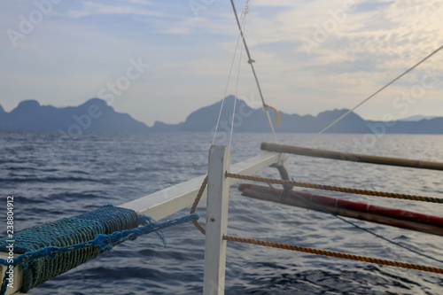 View of the sea and mountains in the horizon from a boat - 238804912