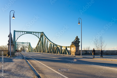 Outdoor scenery on the road at the front of Glienicke Bridge, Glienicker Brücke, which connects Berlin and Potsdam cross Glienicker river in Germany during sunny day.  © Peeradon