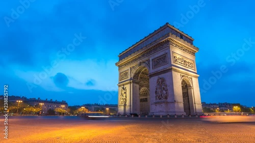Paris France time lapse 4K, city skyline night to day timelapse at Arc de Triomphe and Champs Elysees