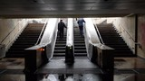 BUCHAREST, ROMANIA - November 22, 2018: People enter and exit an underground train station, during a snowy and cold November morning - 238834746