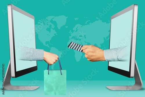 online concept, two hands from displays  hand with shopping bag and