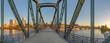 Leinwanddruck Bild - eiserner Steg, famous iron footbridge crosses river Main in Frankfurt with skyline in morning light