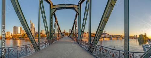 eiserner Steg, famous iron footbridge crosses river Main in Frankfurt with skyline in morning light - 238903116