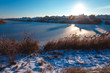 Frozen lake at winter. Early morning light