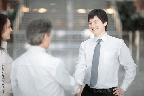 Manager welcomes the client with a handshake