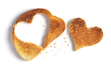 Roasted bread with a cut out heart-shaped piece