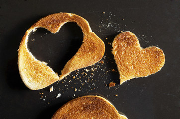 Roasted white bread with a cut in the shape of a heart