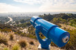 Spyglass on observation deck on Hollywood Hills. Warm sunny day. Beautiful clouds in blue sky.