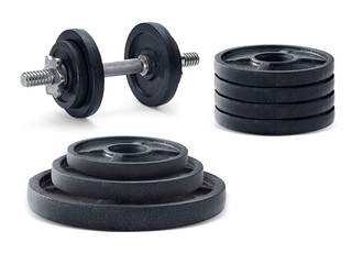 The metal dumbbell and weights isolated on white background © supachai