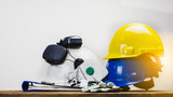 Works safety concept: PPE (Personal Protective Equipment), hard hat or industrial helmet for protection the worker from accident during working at construction site, factory or industry building. - 239054972