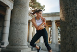 Woman in fitness wear doing workout outdoors