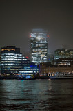 Commercial buildings on the bank of river thames in the mid of rain and snow - 239074175