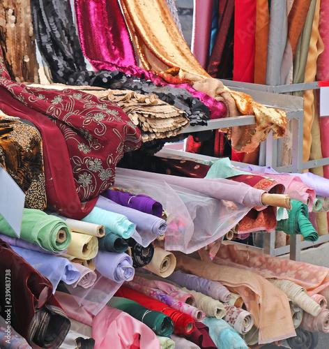 Different colorful fabrics rolls - 239083738