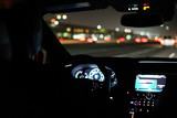 driving a car at night in the city