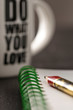 do what you love, still life with block note,  pen and a white mug of coffee over a black office desk. symbol of job