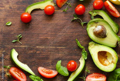 food background avocado, tomato and fragrant herbs - 239107766