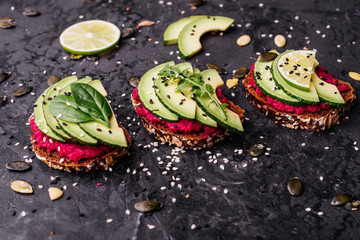 Food, avocado, healthy food. Avocado sandwiches with seeds, sesame and a lime. It can be used as a background