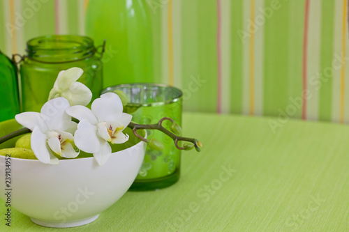 still life zen style with white orchid flower on green - 239134952