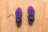 top view of couple of purple sport shoes sneakers on the wooden parquet in the gym f - 239176726
