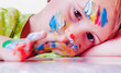 Quadro Art, creativity, beauty childhood concept. Portrait of little cute child girl with colorful hands and face.
