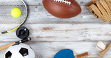 Various sports equipment on white rustic wooden background