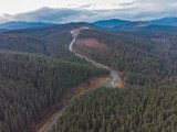 aerial view of highway in mountains on sunset © phpetrunina14