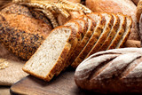 fresh baked bread on wooden background - 239223187