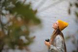 девушка подросток пьёт кофе у моря  - 239265144