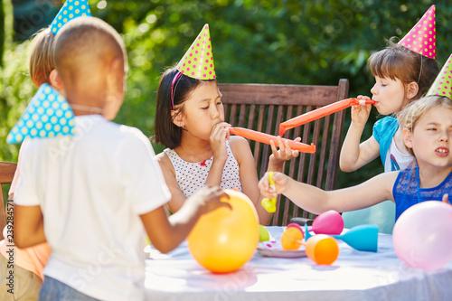 Leinwanddruck Bild Kids at party in summer