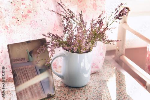 Vintage retro artwork photo. Heather flowers and Starok mirror with reflection.  - 239285189