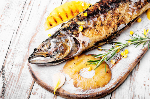 Baked fish with pineapple - 239303711