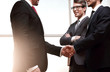 Leinwanddruck Bild - handshake business partners after signing the contract.
