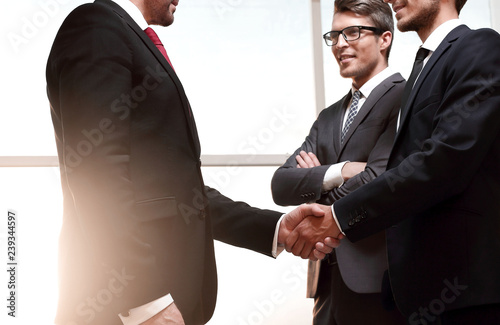 Leinwanddruck Bild handshake business partners after signing the contract.