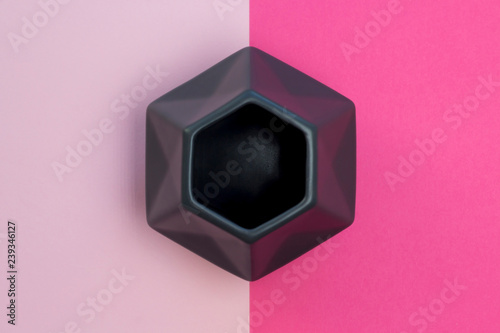 Grey polygonal vase on the geometric background of fashion pink and magenta bright colors, vertical arrangement. Minimal concept pattern. Soft focus, close-up, top view, layout design - 239346127