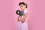 powerful housewife. pin up woman with trendy makeup. retro woman with dumbbell. Sport. pretty girl in vintage style. pinup girl with fashion hair. Up to speed with their fitness goals