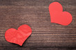 Crumpled paper heart on brown wooden table