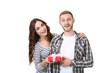 Leinwanddruck Bild - Beautiful young couple with gift box on white background