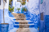 Narrow street of Chefchaouen blue city in Morocco © matiplanas