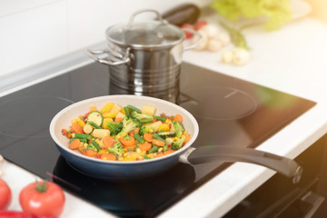 Fresh vegetables fried in a pan. Healthy nutrition concept